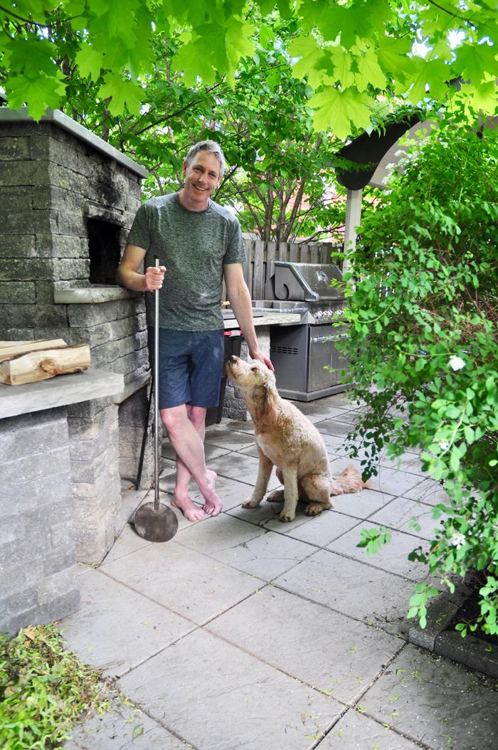 Kitchissippi pizza aficionado Andrew Casey and the family dog, Abby.