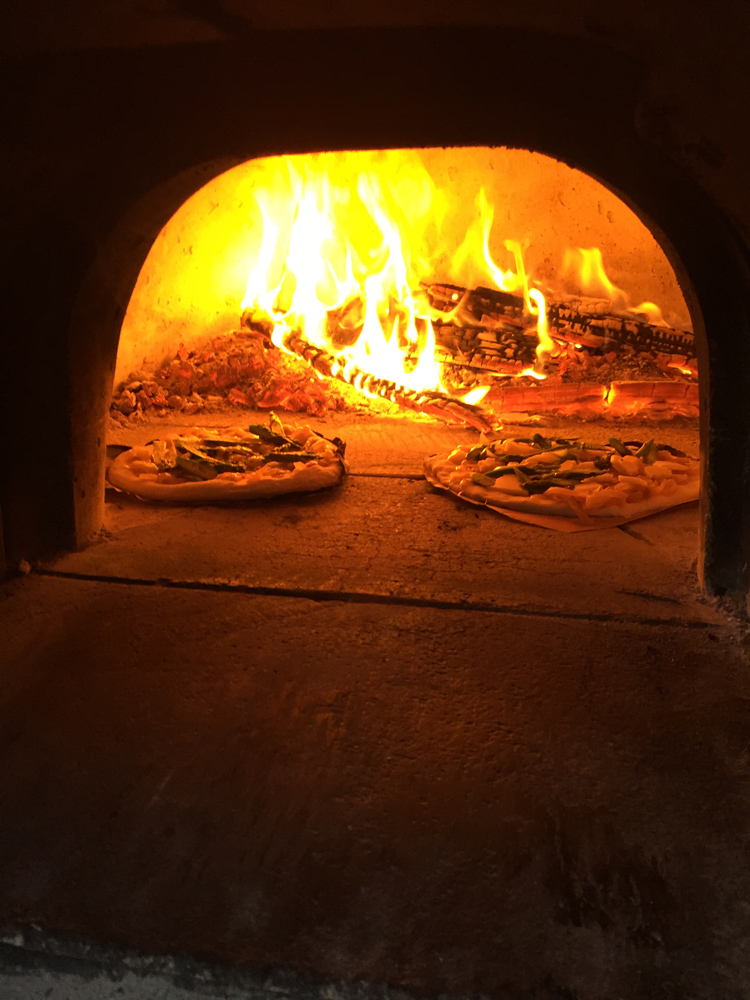 Pizzas baked in a wood-burning oven cook very quickly and at high temperatures.