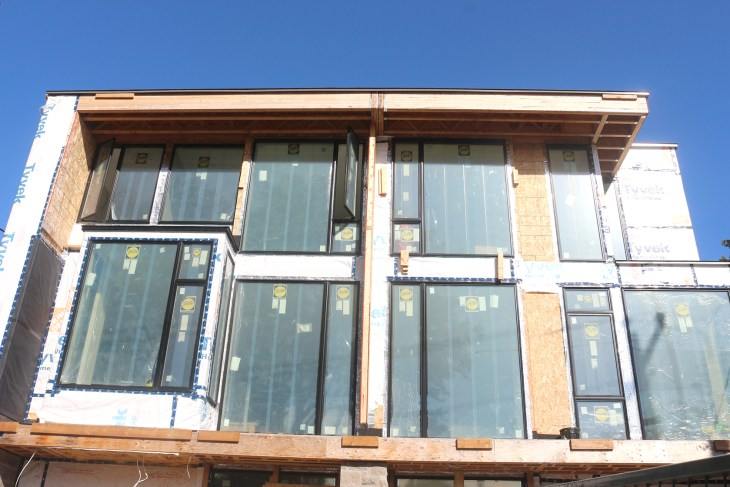 The airiness and openness of both units are the product of the large windows that dominate the south facing wall.
