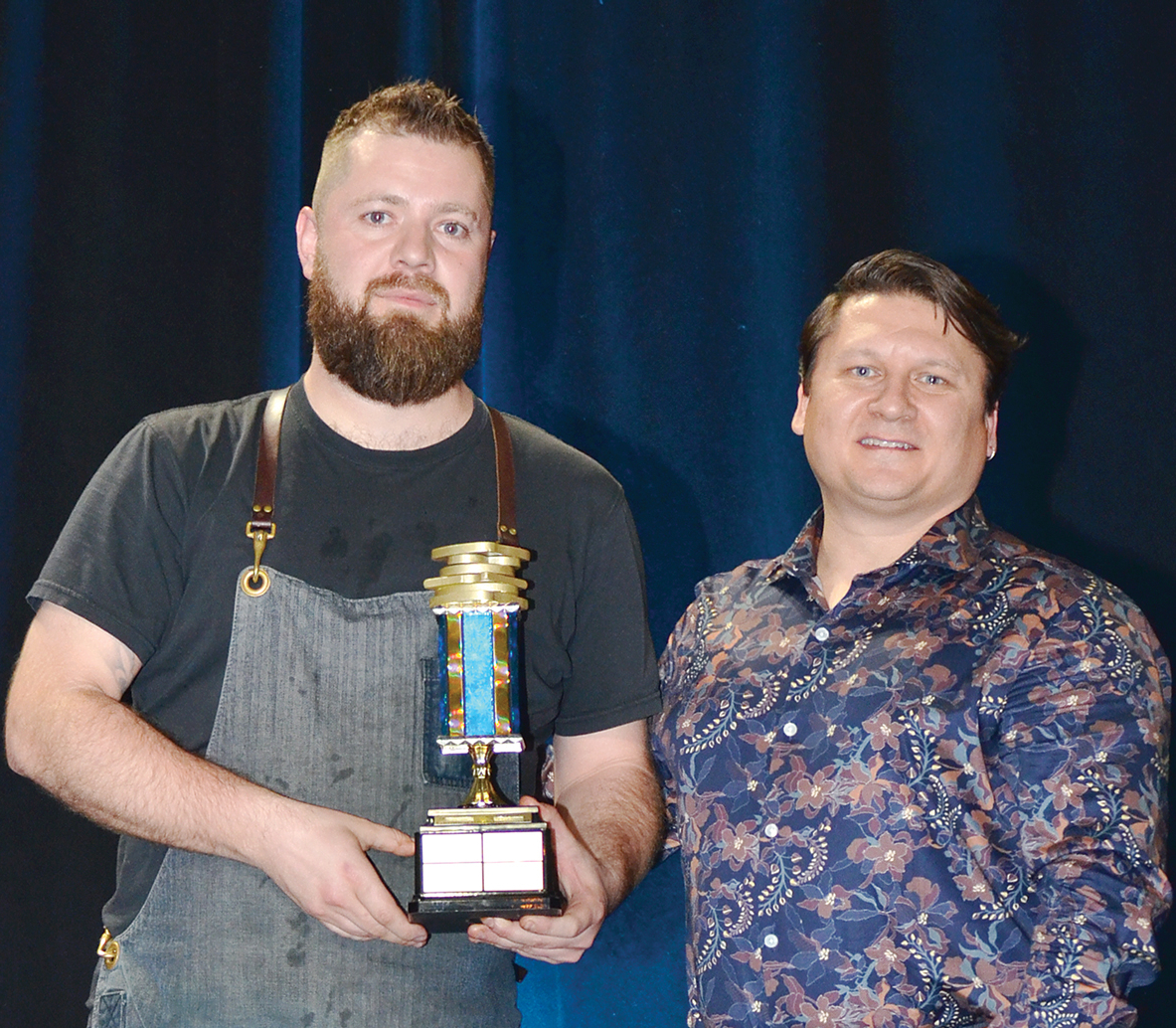 Justin Champagne receives the trophy for best sandwich from Jeff Bond at this year's Hopewell Eating Disorder Centre's Breaking Bread Breaking Stigma competition.
