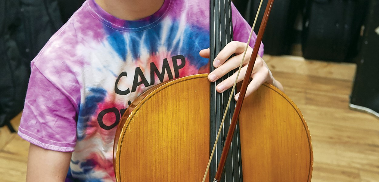 Noah Linson-Hudson, a 14-year-old Kitchissippi resident holds his cello.