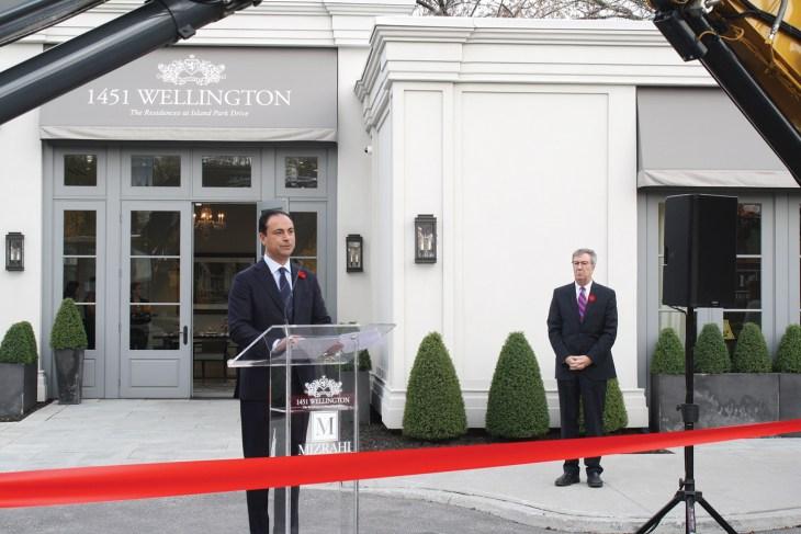 Sam Mizrahi, owner of Mizrahi Developments, with Ottawa Mayor Jim Watson in the background, speaks at the groundbreaking ceremony for a new 12-storey building on Wellington.