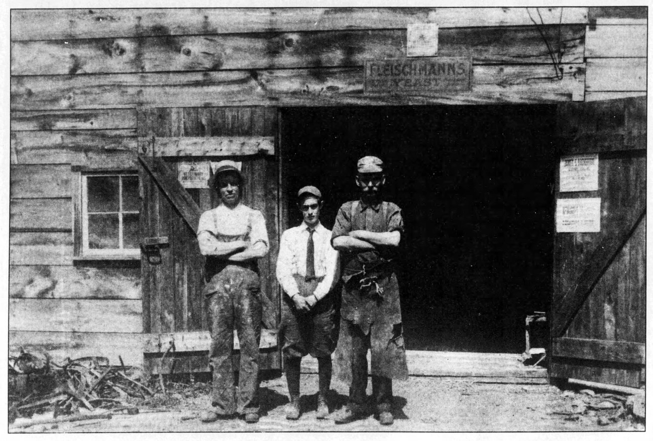 An old photo from 1914, showing Patrick Mears, his son Wilfred and William Pack in front of a blacksmith shop.