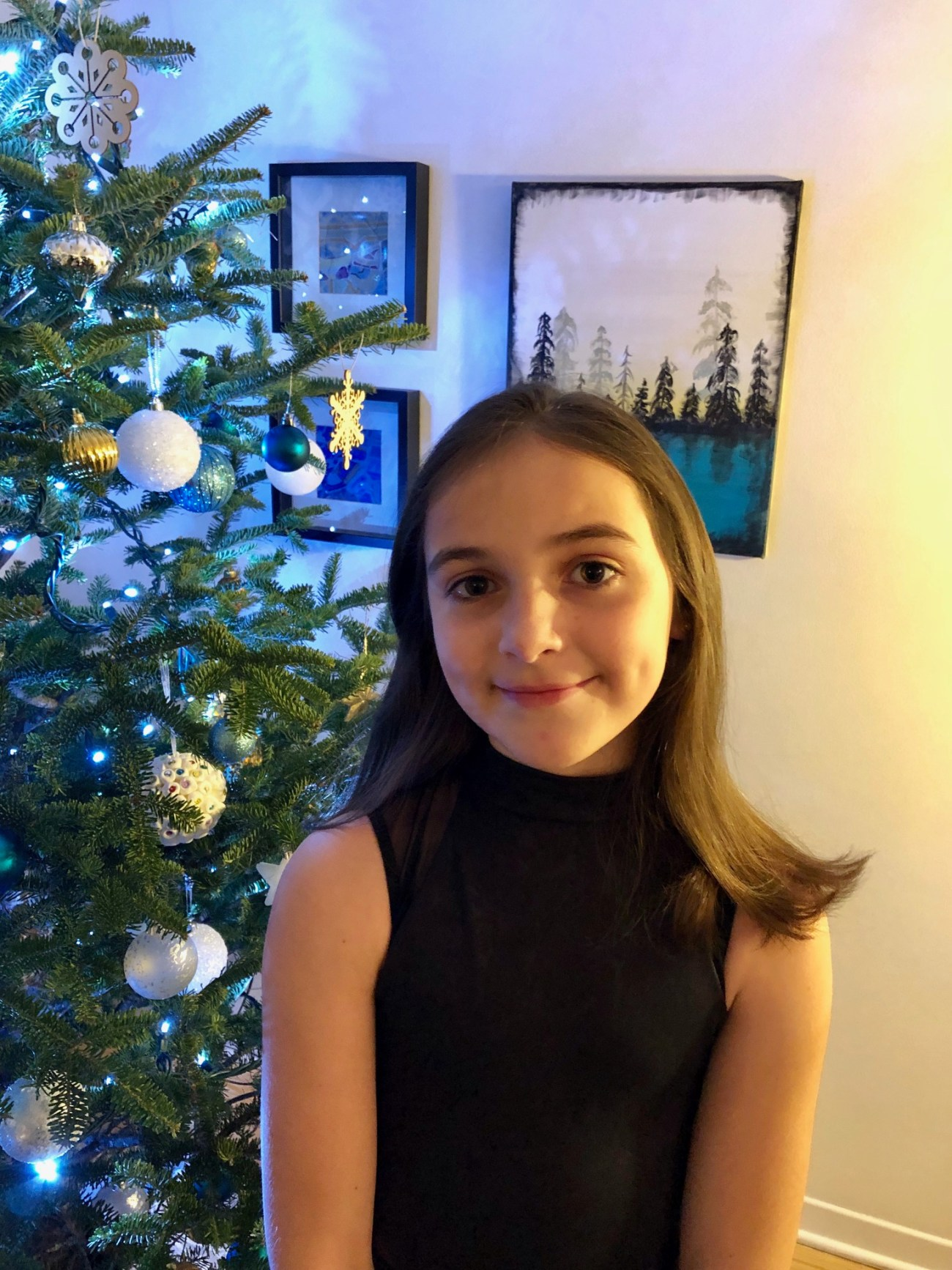 10-year-old Maisie Burchett, who will play one of the chipmunks in this year's performance of Ballet Jörgen' The Nutcracker: A Canadian Tradition at the Shenkman Arts Centre, poses in front of her family's christmas tree.