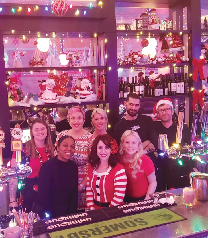 Staff at the Savoy pose behind the bar as they get ready for Miracle Pop-up.