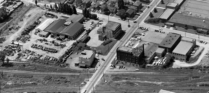 An aerial oblique photo from 1961 which is years after the Oliver factory was gone, but shows the area at least, and the last still-standing Oliver building right by the train tracks. Not useful for the print edition, but maybe a bonus photo for the online edition? National Aerial Photo Library image