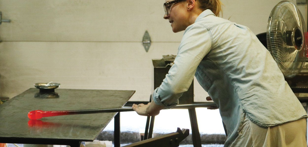 An expert glassblower demonstrates her craft during the Ottawa Glassblowing Cooperative's grand opening in November.