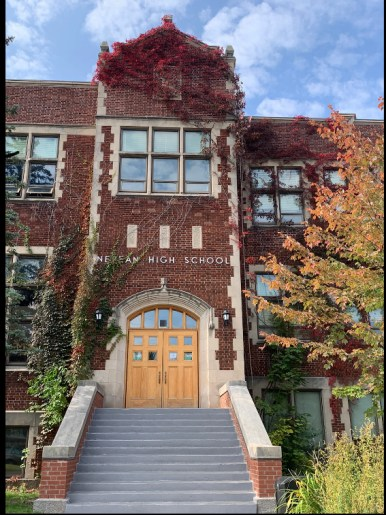 The exterior of Nepean High School in fall.
