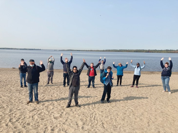 A photo of the members of WAVE outside at Westboro Beach.