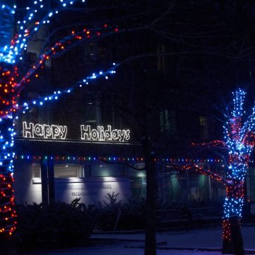 Dark blue and red lights light the Salvation Army Grace Manor in Kitchissippi.