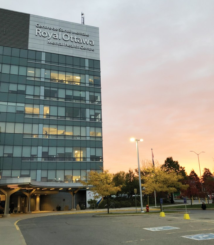 A tall shot of the Royal Mental Health Centre outside at sunset