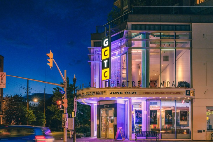 The exterior of the GCTC on an evening with purple lights shining from the theatre