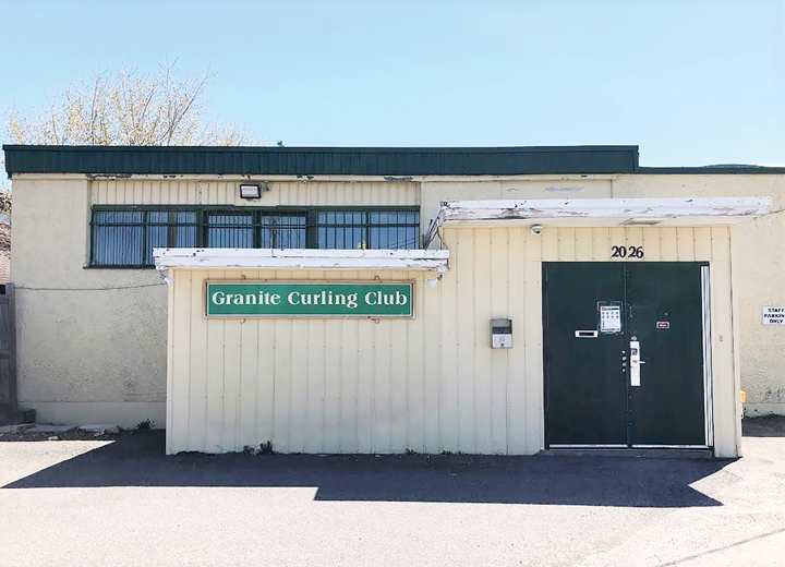 The exterior of the Granite Curling Club on a sunny spring day in Ottawa