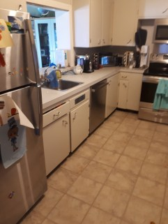 A picture of the kitchen pre-renovation with 1940s style