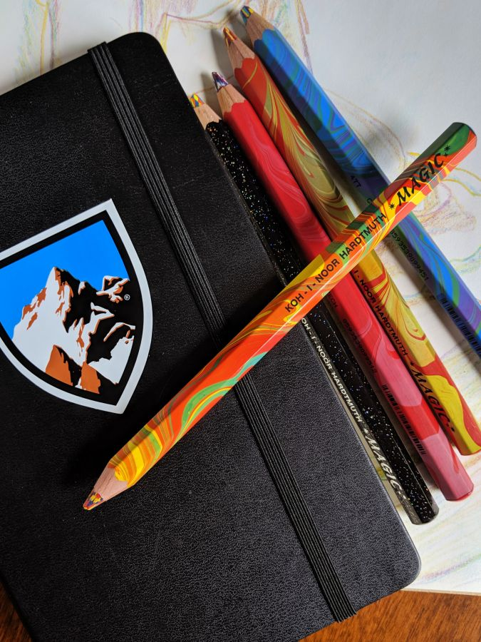Sketchbook and pencils with multicolored leads. Photo by Kit Dunsmore