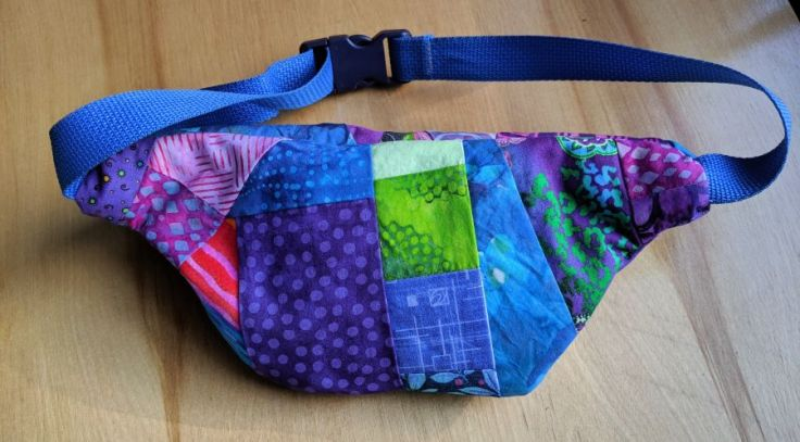 Purple and blue crazy quilted fanny pack, back. Bag and photo by Kit Dunsmore.