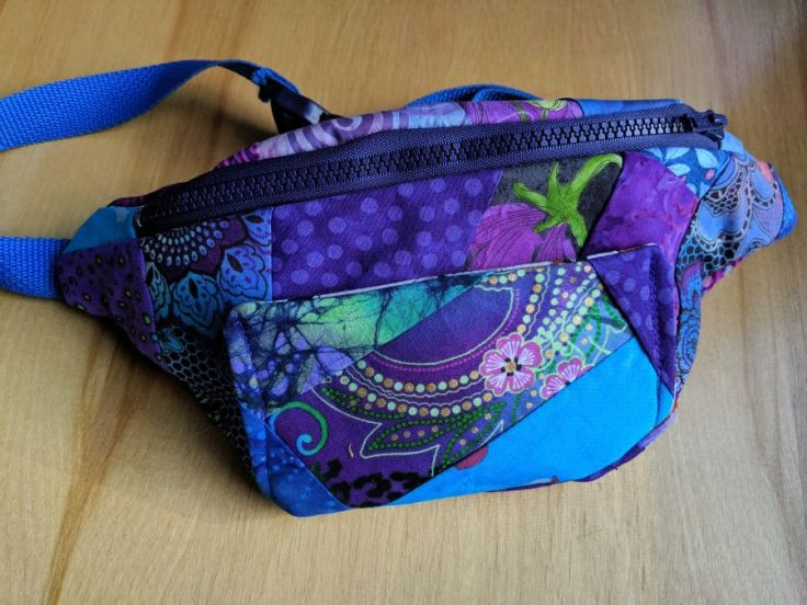 Purple and blue crazy quilted fanny pack, front. Photo and bag by Kit Dunsmore