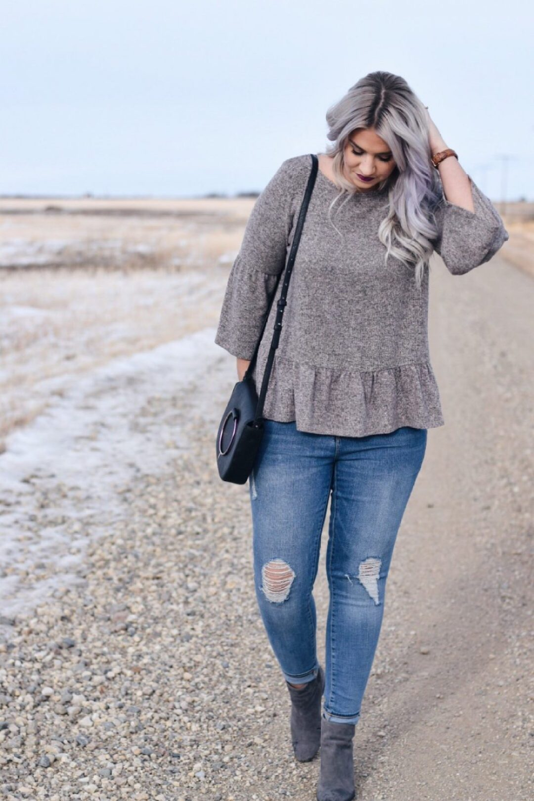 Casual style: Peplum sweater and distressed skinny jeans