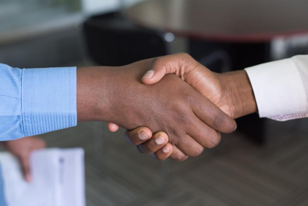 a handshake representing the start of a working relationship