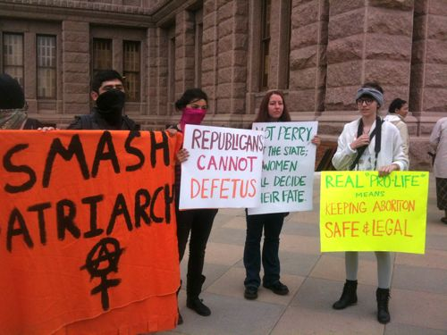 Smash Patriarchy banner and other pro-choice signs