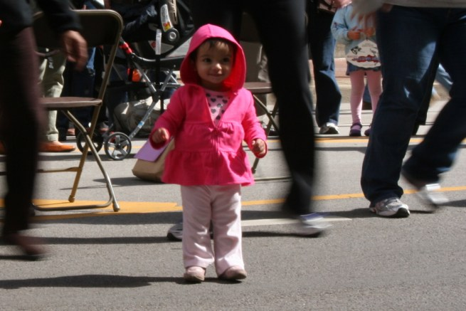 File: A young girl in a pink raincoat. Chicago, October 1, 2011. (Flickr / Stefanie Seskin)