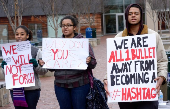 Activists hold signs condemning police violence at a #ReclaimMLK protest in Silver Spring, Maryland. January 24, 2015. (Flickr / Stephen Melkisethian)