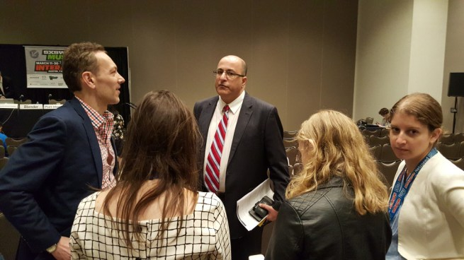 "Admirers surround Ido Aharoni (center), the consul general to the Israeli embassy in New York, before the panel ""Building The Perfect Country"" at the SXSW Interactive conference in Austin, Texas on March 14, 2016."