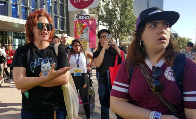 In this March 13, 2016 photograph taken at the Austin Convention Center, a spectator reacts with horror as she realizes she's been speaking with gentrifier Rebecca Gray, owner of the Blue Cat Cafe, which was built on the demolished ruins of a family business in east side Austin. (Kit O'Connell)