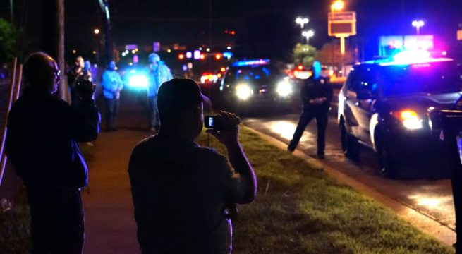 In this March 27, 2016 photograph, two members of the Peaceful Streets Project film a police officer in the Rundberg area of Austin, Texas. (Facebook / Peaceful Streets Project)