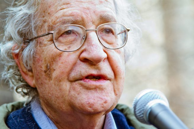 Noam Chomsky speaks on a microphone. April 7, 2011. (Flickr / Andrew Rusk)