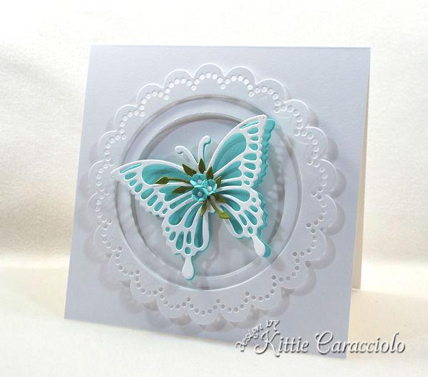 Die cut butterfly wings with flowers are so elegant.