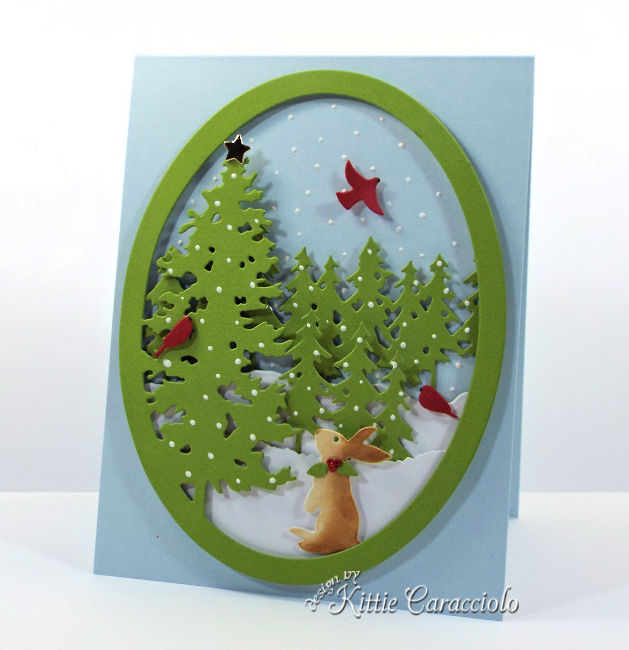Come see how I made this die cut pine tree snow scene.