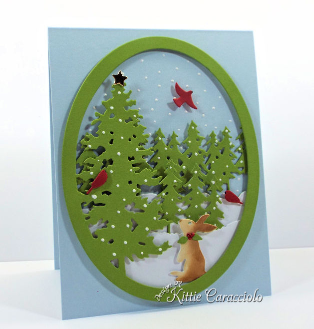 Come see how I made this pretty die cut pine tree snow scene card.