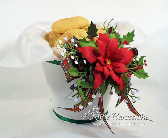 Click thru to see how I decorated this fun Christmas cookie bucket with ribbon and poinsettia.