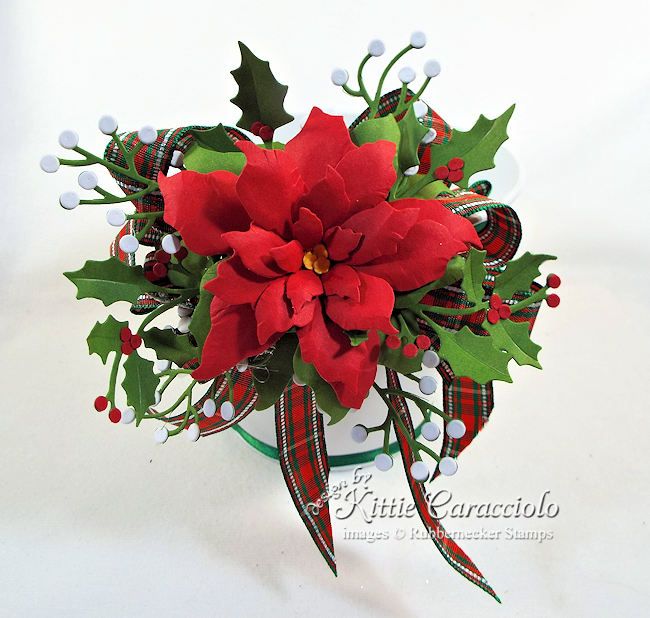 Click thru to see how I decorated this lovely Christmas cookie bucket with ribbon and poinsettia.