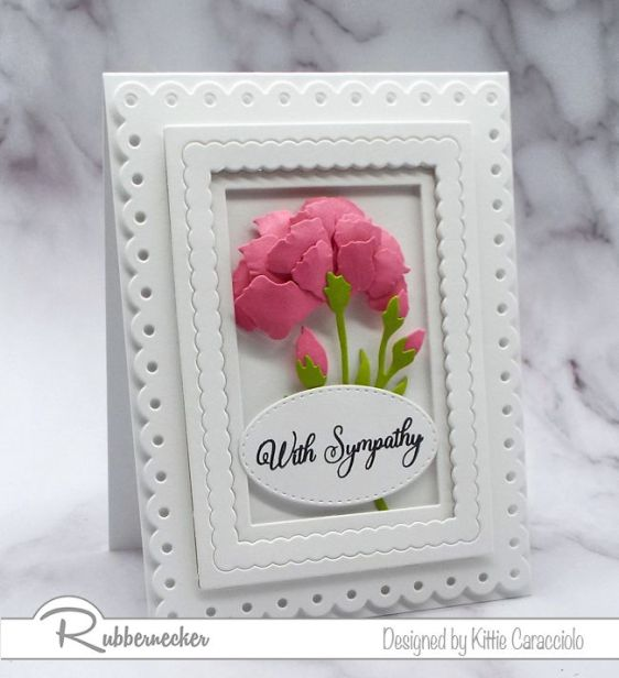 A white on white with pink bouquet handmande greeting card that shows how to shape paper flowers