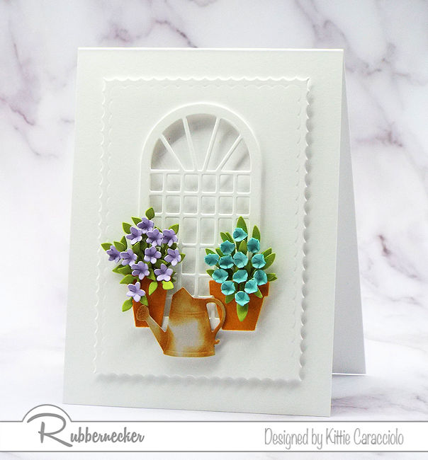 Click on the picture to come see how I create a beautiful white card with colorful flowers using dies made by Rubbernecker.