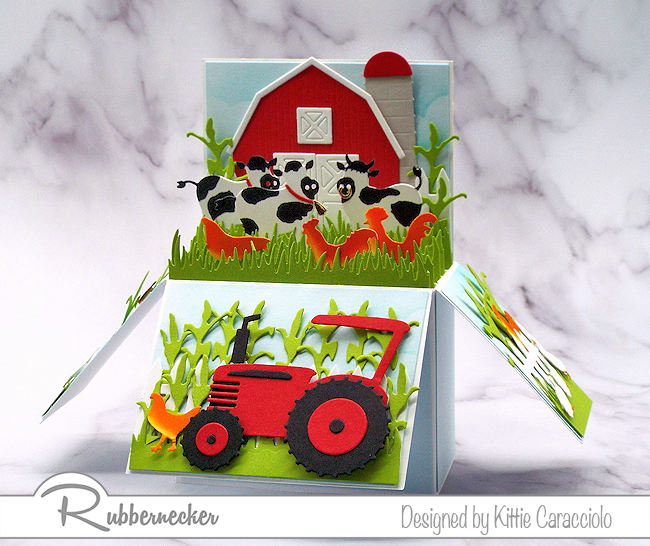 I pulled out all the farm themed dies that I had to create this fun, dimensional farm pop up box card.  All dies are made by Rubbernecker.