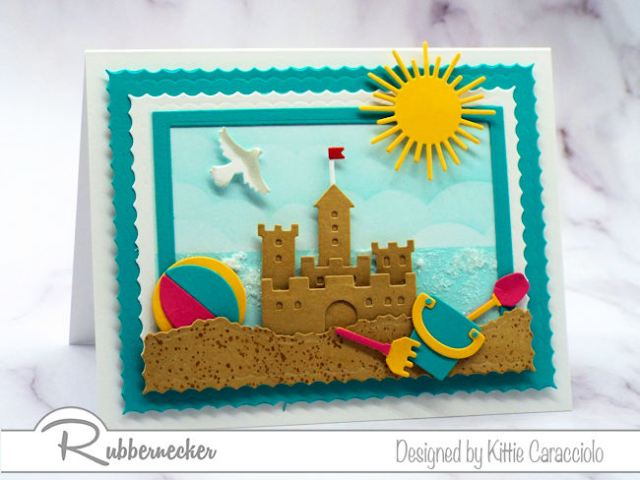 Make a sandcastle beach card with colorful beach toys using dies made by Rubbernecker Stamps.