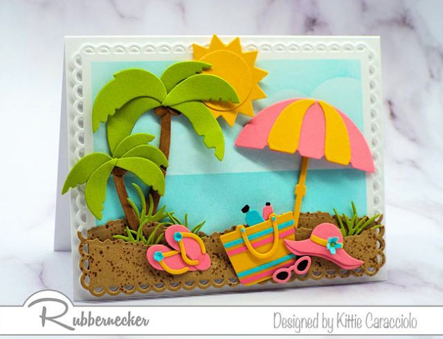 You can find all the wonderful summer themed dies to create a fun beach card at Rubbernecker.