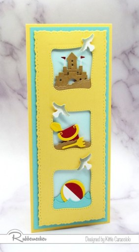 A playful slimline beach card set on the vertical with three tiny beach toy scenes in each of the windows