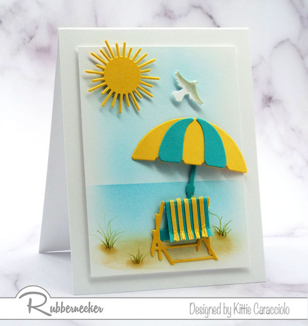 a sample of pretty backgrounds for cards featuring a ocean view and a beach scene made from die cuts