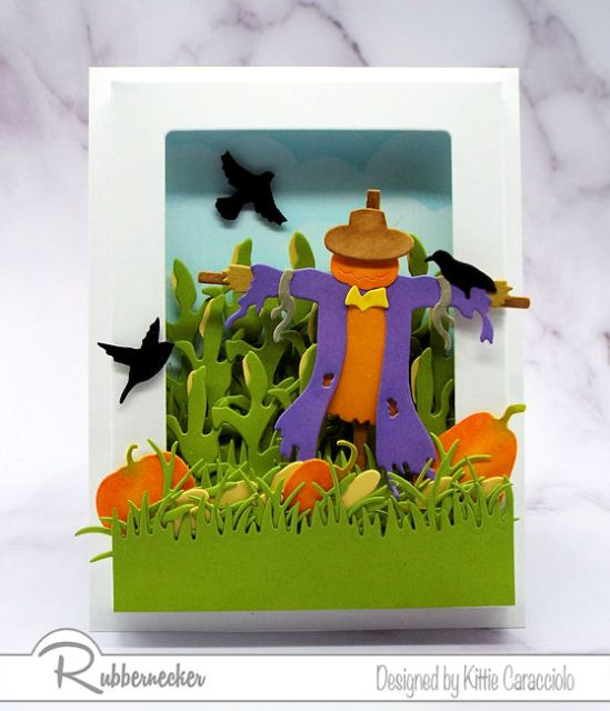 You can make this Scarecrow Shadow Box Card with its pretty fall scene using die cuts from Rubbernecker
