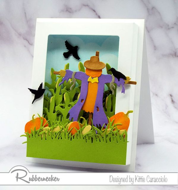A fun Scarecrow Shadow Box Card with corn and pumkins to create a fall scene.