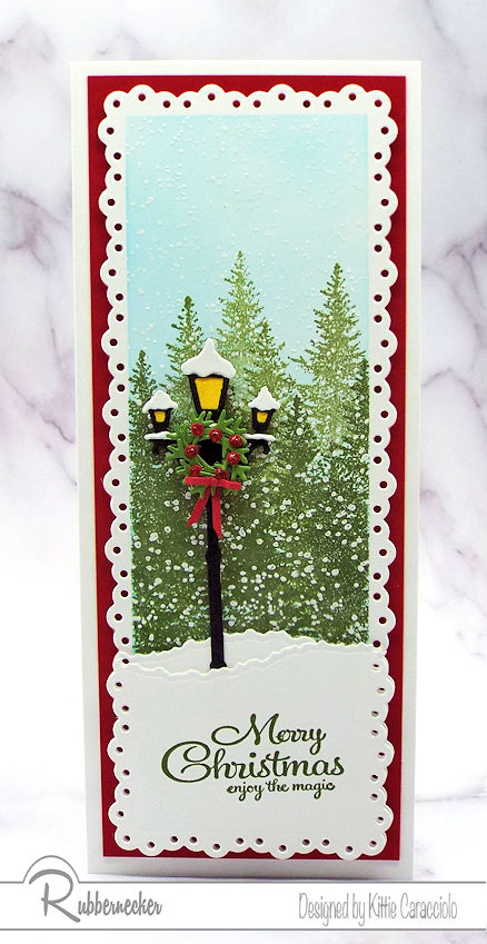 An example of Slimline Winter Scene Christmas Cards featuring a lampost against a background of snowy evergreen trees