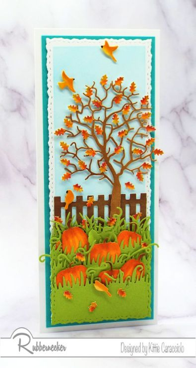 using all die cuts, a slimline fall card featuring a paper tree with shaped leaves and inked pumpkins