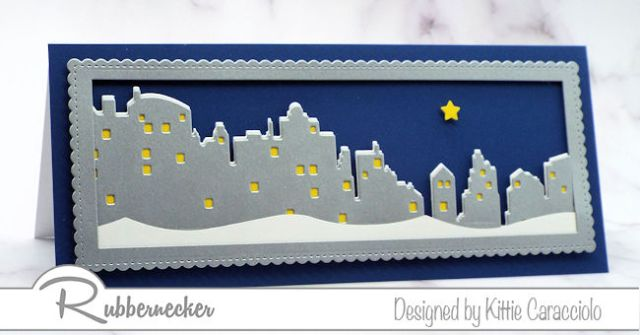 A beautiful handmade card showing a nighttime snowy skyline made using a new slimline skyline die from Rubbernecker