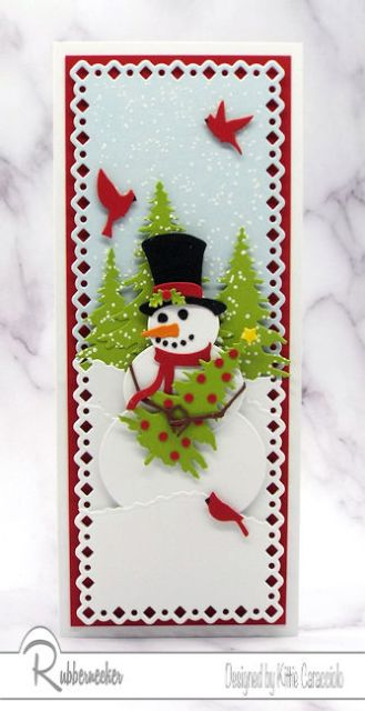 slimline snowman Christmas cards with a die cut snowman holding a Christmas tree in a snowy scene