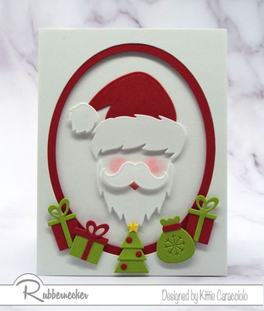 santa Christmas cards made using die cuts from Rubbernecker with a santa face surrounded by tiny gifts