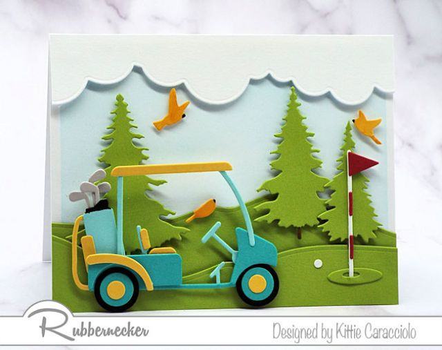 Paper die cuts assembled on handmade cards for golfers showing a golf cart, golf clubs and golf green scene